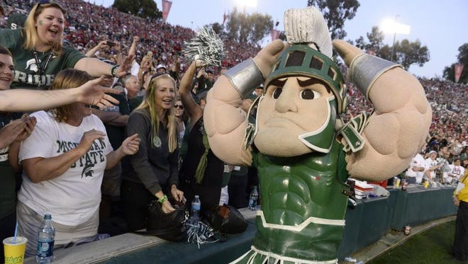 Sparty pumps up the MSU faithful late in  MSU's 24-20 victory over Stanford in the Rose Bowl Jan. 1, 2014.
