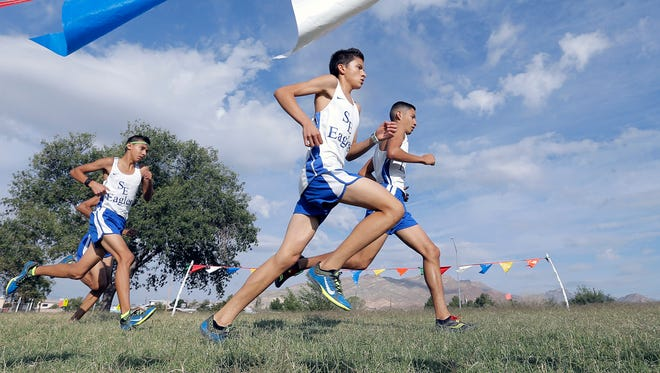 San Elizario's Erick Arambula, center, won the boys' District 3-4A title in cross-country at the Chamizal National Memorial last month.