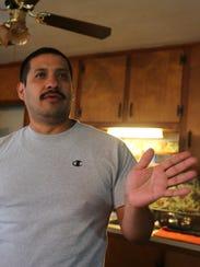 Oscar Duarte talks inside his Southern Indiana home.