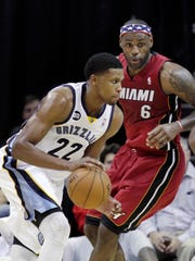 Miami Heat forward LeBron James (6) defends against Memphis Grizzlies forward Rudy Gay (22} during the first half of an NBA basketball game in Memphis, Tenn., Sunday, Nov. 11, 2012. (AP Photo/Danny Johnston)