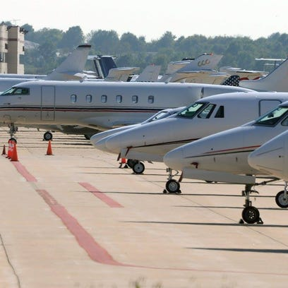 Lines of private jets parked at the Springfield-Branson