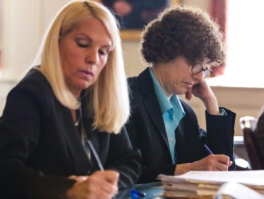 Deputy Attorney General Gene Rosenblum, on right, and