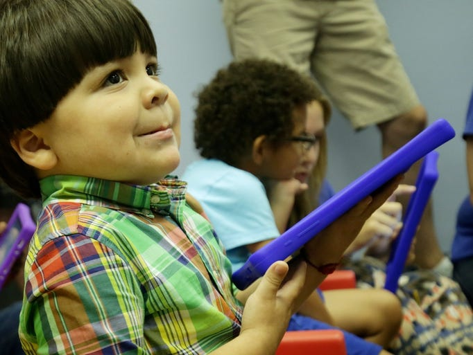 Aristeo Lopez-Hernandez, 4, of Lincoln Park, MI, plays