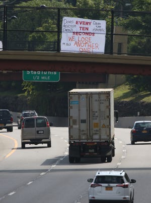 A sign hung on an I-490 overpass in August shows the extent of the opioid problem in the area. Some health centers received federal money in September that will let them increase services for people with substance abuse problems and with mental health issues.