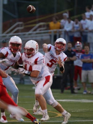 Penfield's Quarterback Patrick Bowes throws a short pass.