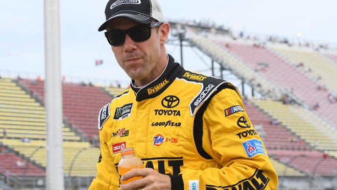 Matt Kenseth waits during qualifying for the FireKeepers Casino 400 at Michigan International Speedway.