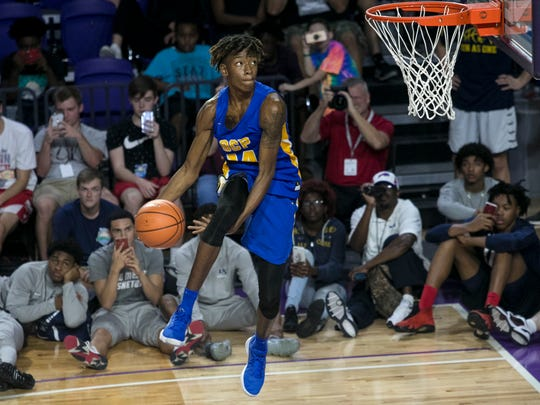 CJ Walker of Orlando Christian Prep does one of his dunks that got him into the finals of the dunk contest at the City of Palms Classic on Wednesday in Fort Myers. Walker was the runner-up.