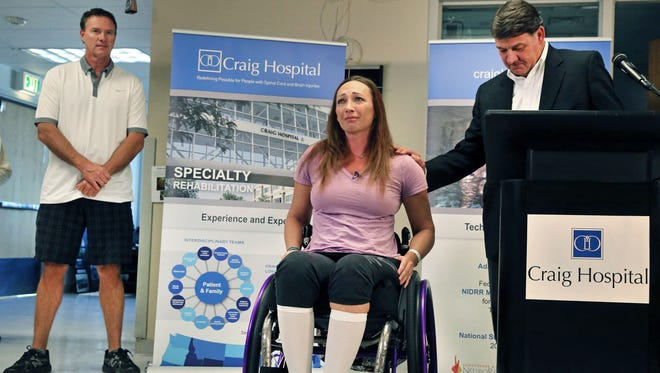 Amy Van Dyken-Rouen, center, talks about inspirational staff and fellow patients on the day of her discharge from Craig Hospital in Englewood.