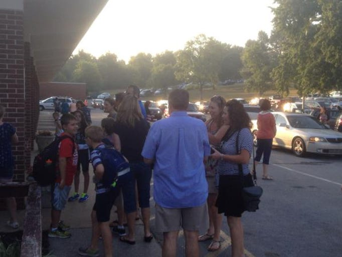 Students and parents arrive at Lakeview Elementary in Wilson County for the first day of school Friday, Aug. 1, 2014.