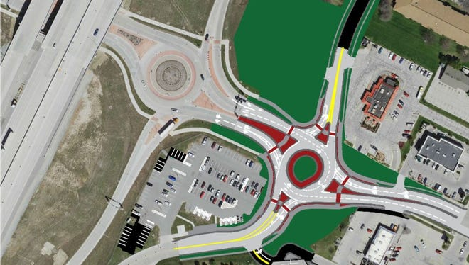 A roundabout at Main Street and Lawrence Drive in De Pere is expected to relieve traffic congestion while opening an area north of Lawrence Drive for new development.