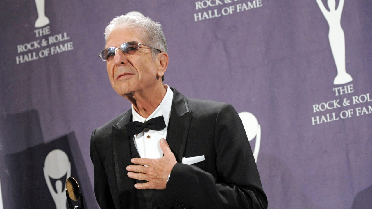 Singer-songwriter Leonard Cohen died in his sleep after falling down in the middle of the night at his Los Angeles home, his manager said Wednesday.