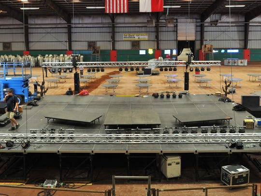 Workers from Peek Pro Audio set up the main stage Thursday