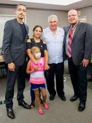 Linden resident Mark Mannuzza was honored at the June 26 meeting of the Linden Board of Education. From left are board member Ahmed Shehata, Diana Arubla with her daughter Isabel Dominguez, Mannuzza, and Superintendent Danny A. Robertozzi.