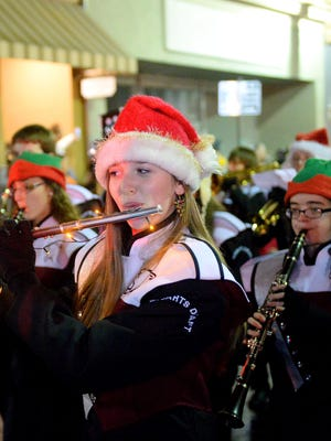 Stuarts Draft High School's marching band marches during the Staunton Christmas parade in 2014.