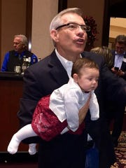 U.S. Rep. David Schweikert, D-Ariz., and his recently adopted daughter Olivia at a holiday fundraising party Dec. 21.