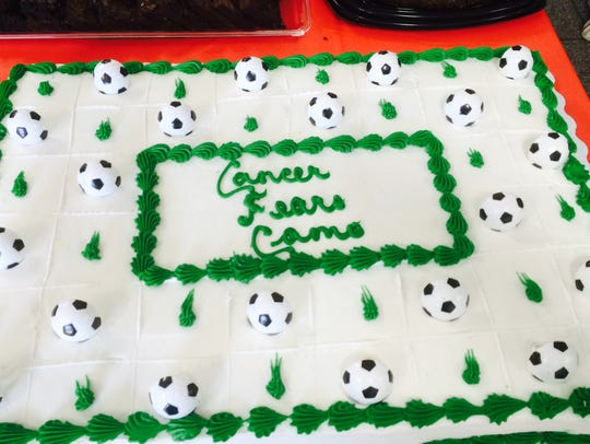 """Cancer Fears Camo"" cake for Cameron, an avid soccer"