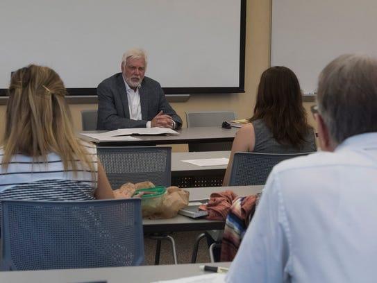 University of West Florida professor Bob Perkins meets