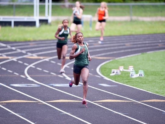 Rice's Sonia John rounds the final turn en route to