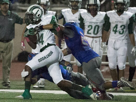 Montwood wide receiver Tyreese Andrus is brought down,