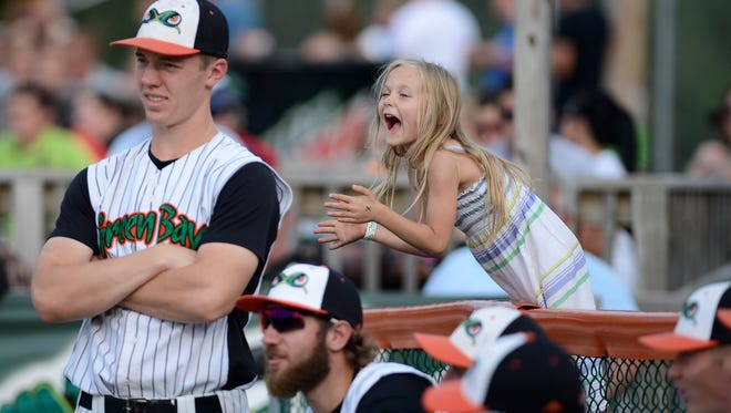 """""""Not many fans get to cheer right over the dugoutÑunless your older brother is on the team.""""  Appleton resident Aubrey Disch, 5, cheers on the Green Bay Bullfrogs in their final game of the season against the Wisconsin Rapids Rafters at Joannes Stadium in Green Bay Wis. on Sunday, Aug. 10, 2014. Disch's brother Nathan is a pitcher for the team and said his sister comes out to support him at every home game."""