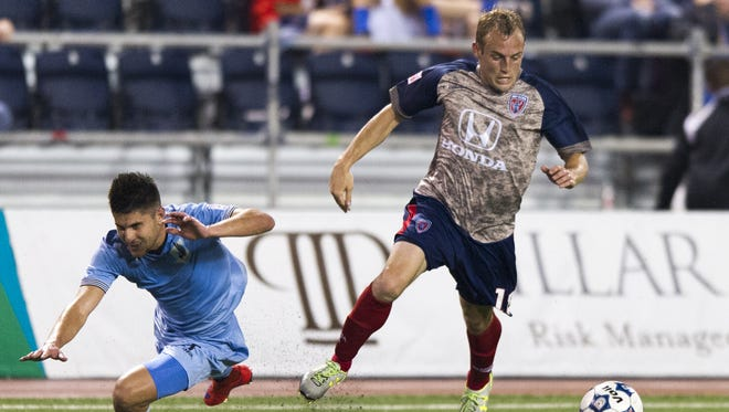 "Indy Eleven forward Wojciech Wojcik (19) get the ball away from the driving effort of Minnesota United FC defender Kevin Venegas (7) during second half action. Indy Eleven hosted Minnesota United FC in NASL soccer action, Saturday, May 16, 2015, at ""The Mike"" on IUPUI's campus in Indianapolis. Minnesota won 3-1."