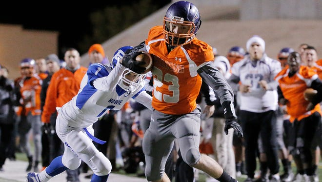 Eastlake wide receiver Isaiah Holguin tries to stay in bounds but can't as he is shoved out of bounds by Bowie's Angelo Alfaro Thursday night in their 5A bi-district game at the Socorro Student Activities Complex.