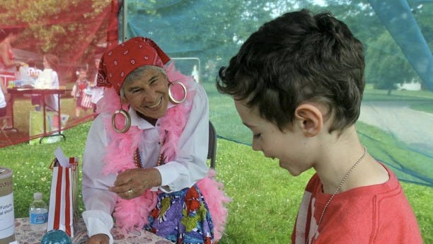Volunteer Erica Kantor, in the role of a fortune teller, spends time with Jack Pearl, 8, of Blauvelt, during a carnival at Camp Grief Busters at the Stony Point Center June 8, 2014. The two-day camp, held by Hearts & Crafts Grief Counseling, is for children and parents who are coping with the loss of loved ones. The camp culminated with the carnival, which included food, crafts and therapeutic games designed to help with the process of grieving. Jack, whose father died in 2013, was at the camp with his mother and brother.
