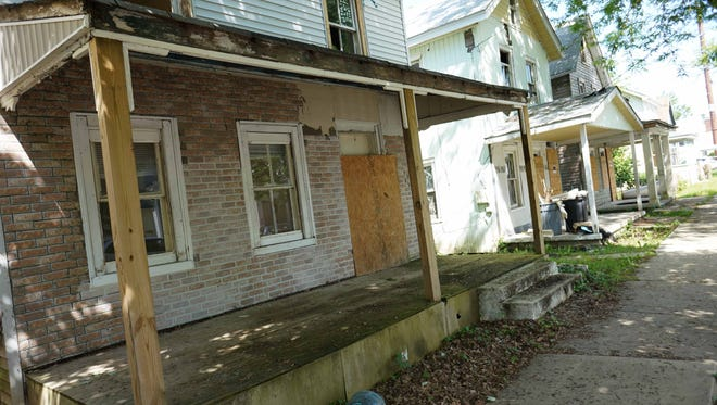 Five properties along North Kirkwood Street in Dover will be demolished and replaced by four new houses built by Strong Neighborhood Housing Funds.