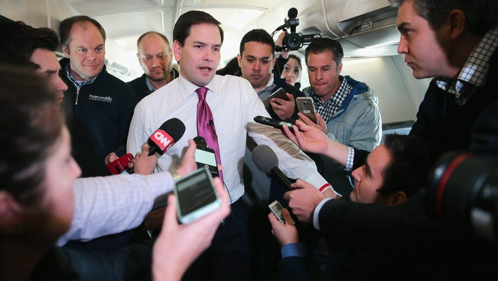 Republican presidential candidate Sen. Marco Rubio, R-Fla., talks with reporters on his charter flight from Manchester-Boston Regional Airport en route to Spartanburg, S.C.. Rubio placed fifth in the New Hampshire primary, behind fellow GOP candidates Jeb Bush, John Kasich, Sen. Ted Cruz, R-Texas,  and Donald Trump, who swept away the competition with 35% of the vote.