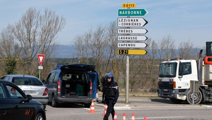 French gendarmes block the access to Trebes, where