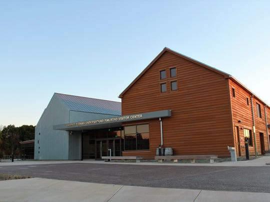 """The front of the visitor center at the Harriet Tubman Underground Railroad National Historical Park, designed as """"The View North,"""" oriented to take visitors from the red timber of Harriet Tubman's youth on the southern end of the building and onward to the possibilities of freedom offered in the north."""