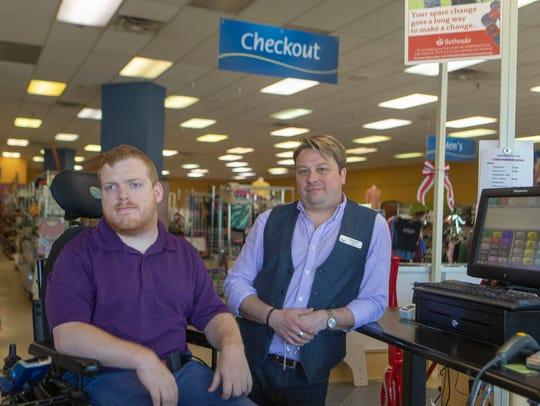 Bethesda Thrift Store manager Sean Kuczynski (right)