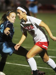 Dixie Heights senior Lauren Nemeroff moves past a Boone defender Oct. 8.