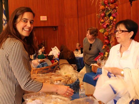 "Alice Novak, left, examines the ""sweet table"" as Lynne"