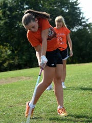 National Trail High School girls golfers Makenna Jones, left, and Allison Brubaker practice Friday, Sept. 23, 2016 at Highland Lake Golf Course in Richmond.