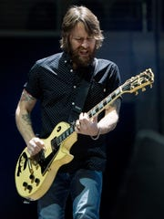 Foo Fighters guitarist Chris Shiflett performs during the band's show at the Denny Sanford Premier Center in Sioux Falls, S.D. on Saturday, Nov. 11, 2017.