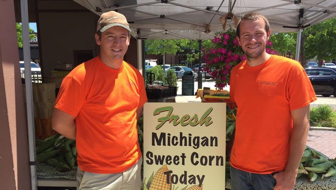 Michigan sweet corn made its debut at the Tuesday Afternoons market in downtown Farmington. Pictured are Chad and Trevor Fusilier from the Fusilier Family Farm.