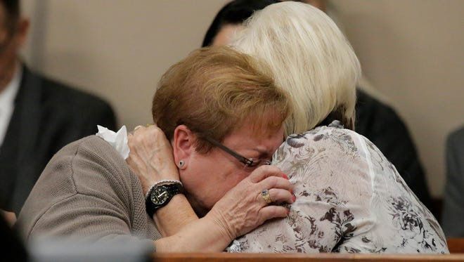 Family members react to the verdict as it is read in the courtroom by the jury foreperson. Lisbeth Garrett, 76, was found guilty on one count of murder by a jury of nine men and three women in the 1977 death of Fort Bliss Army Maj. Chester Garrett in the 168th District Court, with Judge Marcos Lizarraga presiding over the trial that lasted six days.