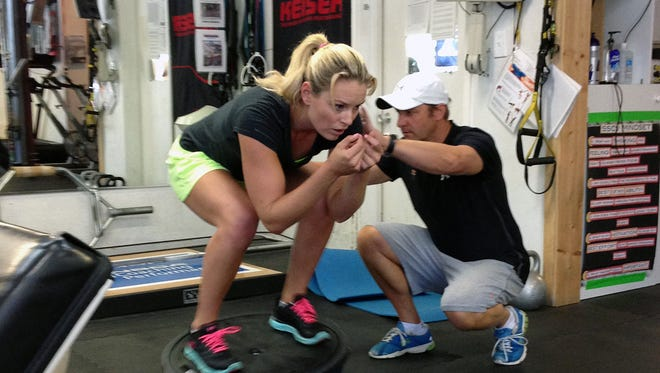 Lindsey Vonn works out with Red Bull coach Martin Hager in Vail, Colo.,  on Wednesday.