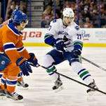 Talbot stops 40 shots, Oilers top Canucks 2-0