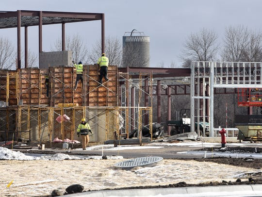 Crews work on the new Sartell Community Center Friday,