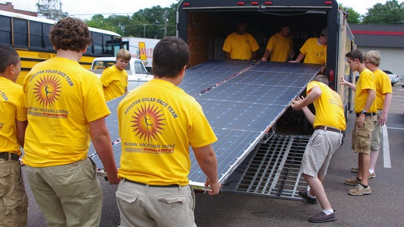 A students from Houston, Mississippi, take care of their solar car before meeting with the Rotary Club in Grenada.