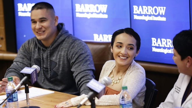 Frank and Jovanna Calzadillas smile during a press conference at Barrow Neurological Institute on Jan. 24, 2018, in Phoenix, Ariz. Jovanna Calzadillas will be discharged from the hospital tomorrow. Calzadillas was shot in the head on Oct. 1, 2017, when a gunman opened fire on the Route 91 Harvest music festival in Las Vegas, Nevada.
