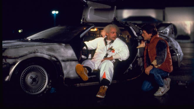 Christopher Lloyd as Doc Brown and Michael J. Fox as Marty McFly in a scene from the motion picture 'Back to the Future.'