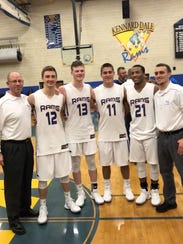 "The four seniors on the Kennard-Dale boys' basketball team are called ""The Quad."" They have been with head coach Jake Roupe since middle school. Shown from left to right are: assistant coach Greg Freese, Joey Thomas, Adam Freese, Craig Potts, Donnell Williams and Roupe. Greg Freese is Adam's father."