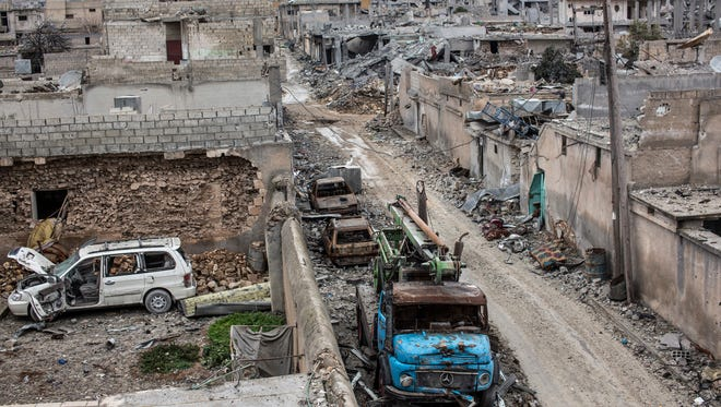 In this In this Jan. 30, 2015 file photo, rubble and damaged buildings are seen in the devastated Syrian city of Kobani.