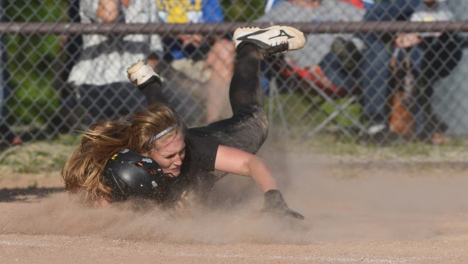 Tri-Valley's Riley Paxson slides and scores against Maysville. Paxson was named first-team All-Ohio and the MVL player of the year.
