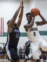 Cordova's Rodgerick Brown goes up for a shot against