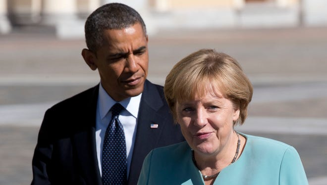 President Obama walks with Germany's Chancellor Angela Merkel in St. Petersburg, Russia, on Sept. 6.