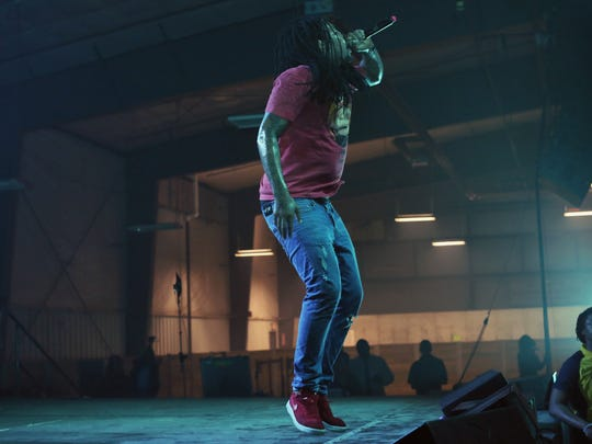 Rapper Waka Flocka Flame performs on Iowa State University campus Tuesday night. The set was cut short by concert officials due to safety concerts of some fans.